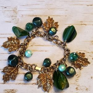 Bracelet green stone beads gold tone leaves